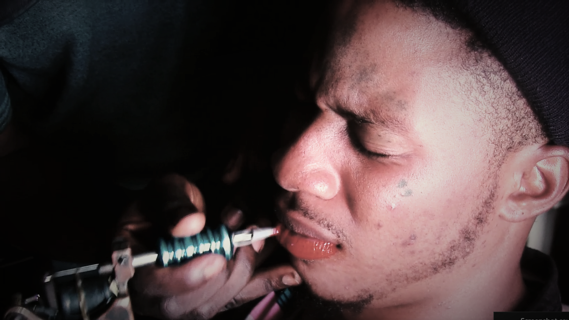 TRUE Africa | The Lagosian men who tattoo their lips pink