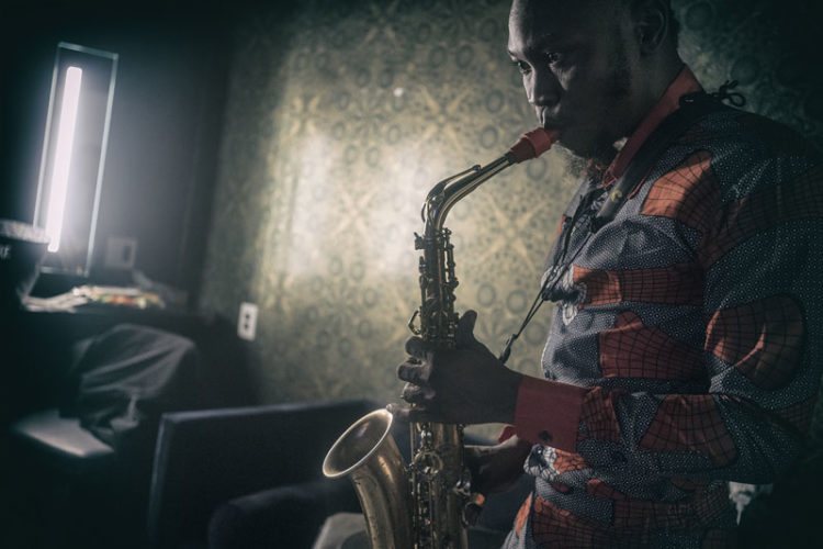 Seun Kuti playing a saxophone