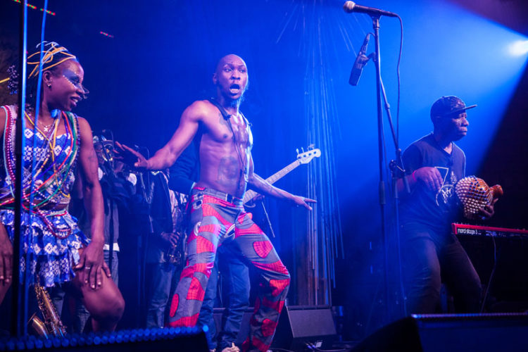 Seun Kuti on stage dancing